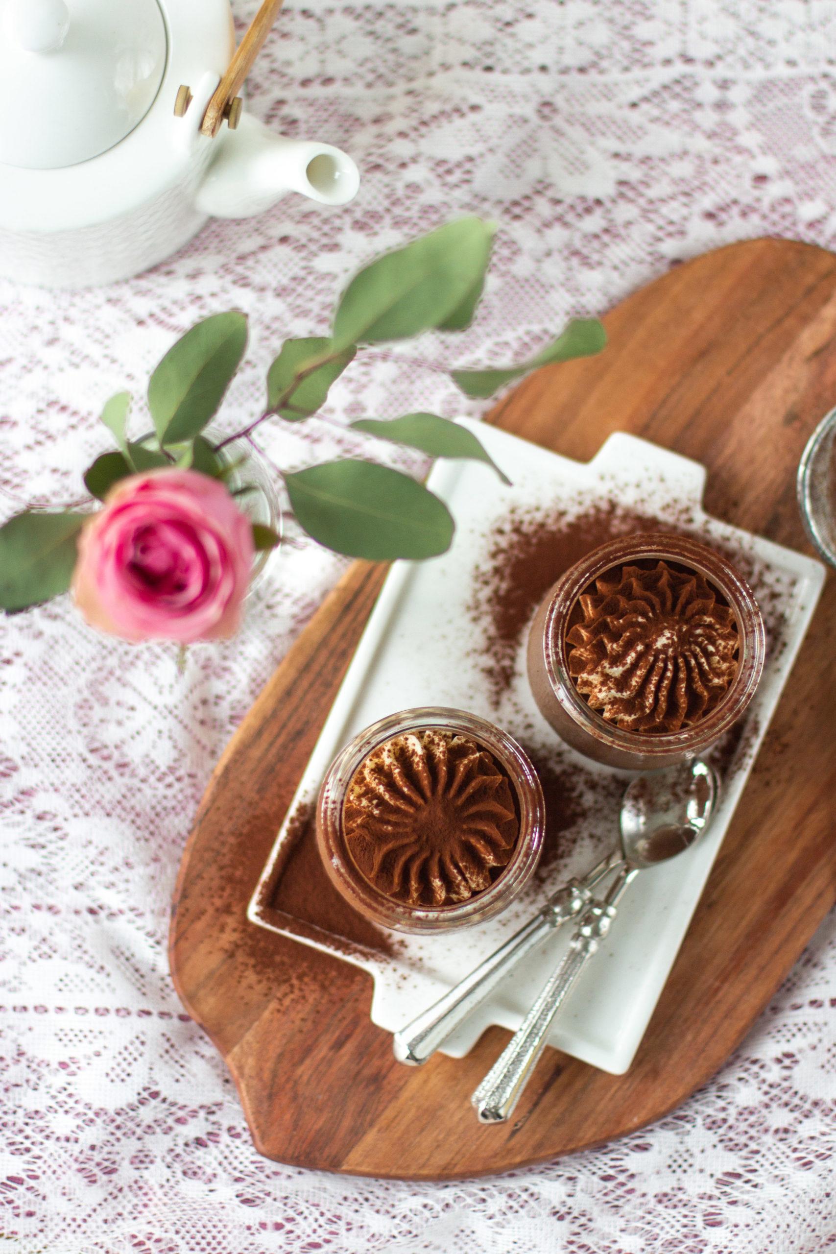 Chocolate panna cotta dessert with whipped cream and coca powder